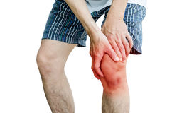 Male holding hand to spot of knee-aches Stock Photos