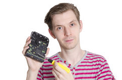 Male holding hard disk and screwdriver Stock Photo
