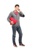 Male holding a heart shaped pillow Stock Image