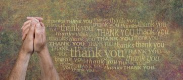 Thank you Prayer Hands Rustic background. Male holding his hands in the prayer position with a word cloud that repeats the words THANK YOU against a rustic Royalty Free Stock Images