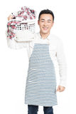 Male holding a laundry basket Royalty Free Stock Images