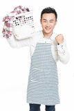 Male holding a laundry basket Royalty Free Stock Photography