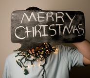 Male Holding Merry Christmas Sign Stock Photos