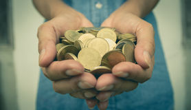 Male holding money gold coins in her hand for financial royalty free stock image