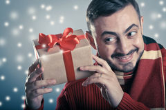 Male holding a red ribbon gift box Stock Photos