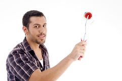 Male holding roller brush Royalty Free Stock Photos