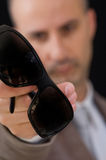 Male holding sunglasses Royalty Free Stock Images