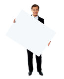 Male holding tilted blank billboard Royalty Free Stock Photos