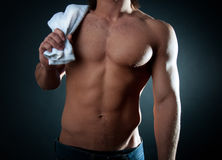 Male holding towel on his shoulder stock photo