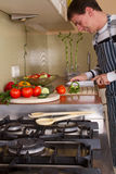 Male in home kitchen Royalty Free Stock Image