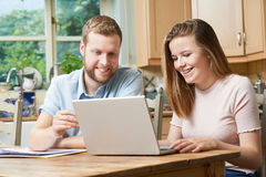 Male Home Tutor Helping Teenage Girl With Studies. Male Home Tutor Helps Teenage Girl With Studies Royalty Free Stock Images