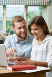 Male Home Tutor Helping Teenage Girl With Studies Royalty Free Stock Photography