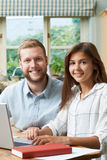 Male Home Tutor Helping Teenage Girl With Studies Royalty Free Stock Image