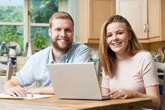 Male Home Tutor Helping Teenage Girl With Studies Royalty Free Stock Photos