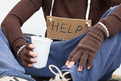 Male homeless with sign. Male homeless sitting on a street with sign asking for help Stock Photos