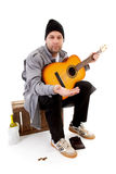 Male homeless tramp. With guitar over white background Royalty Free Stock Photo