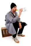 Male homeless tramp with empty bottle Royalty Free Stock Image