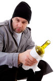 Male homeless tramp with empty bottle Royalty Free Stock Photography