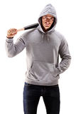 Male with hood over his head holding a baseball bat. Symbolizing crime isolated on white background Royalty Free Stock Photos