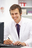 Male hospital doctor at desk Stock Image