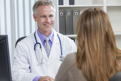 Male Hospital Doctor Talking to Female Patient Stock Photography
