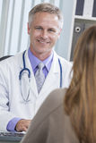 Male Hospital Doctor Talking to Female Patient Stock Image