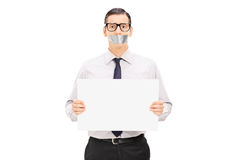 Male hostage holding a blank banner. Isolated on white background Royalty Free Stock Image