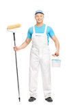 Male house painter holding a paint roller Royalty Free Stock Photography