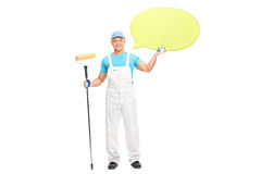 Male house painter holding a speech bubble Stock Photography