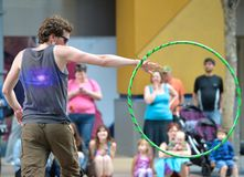 Male Hula Hooper. A male hula hooper performs a trick at Edmonton's Pride parade Stock Photos