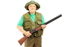 Male hunter holding a rifle Stock Photos