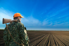 Male hunter looking at field during hunt season. Royalty Free Stock Photo