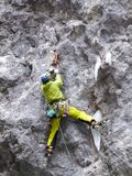 Male ice climber on a dry tooling route in the Italian Alps. A male ice climber on a dry tooling route in the Italian Alps Royalty Free Stock Photo