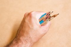Male illustrator and sketch artist with handful of pencils. Selective focus Royalty Free Stock Photo