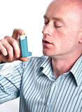 Male with inhaler on white backdrop Stock Photos