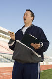 Male Instructor On Racing Track Stock Image