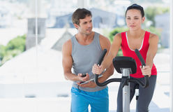 Male instructor working out at spinning class Royalty Free Stock Image