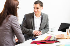 Male Interior Designer With Client Stock Images