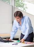 Male Interior Designer Using Laptop Royalty Free Stock Photography