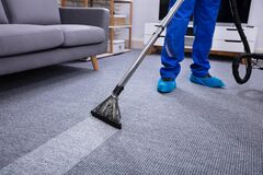 Free Male Janitor Cleaning Carpet Royalty Free Stock Photography - 181463447