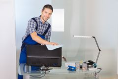 Male janitor cleaning office Royalty Free Stock Images