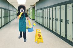 Male janitor gives announcement about wet floor Stock Images