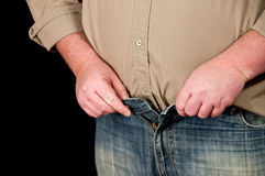 Male in jeans open waistline on black background Stock Photos