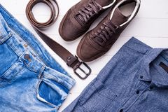 Male jeans and shirt with brown belt and shoes. Blue male jeans and shirt with brown belt and shoes, top view Stock Photo