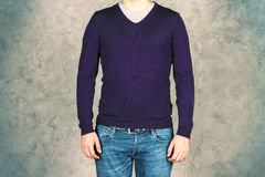 Male in jeans and shirt. Male in jeans and purple shirt on concrete background. Mock up Royalty Free Stock Images