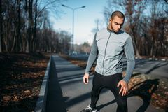 Male jogger on fitness workout outdoors. Runner in sportswear on training in park. Jogging or running royalty free stock image