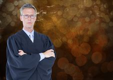 Male judge arms folded against brown bokeh stock images