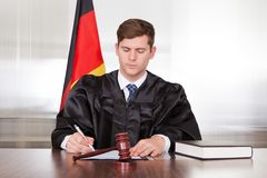 Male judge in courtroom Stock Image