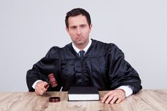 Male judge in a courtroom Stock Images