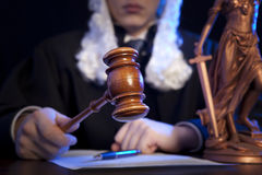 Male judge in a courtroom striking the gavel Royalty Free Stock Image